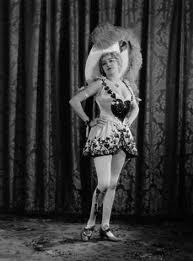As burlesque star Kitty Darling.
