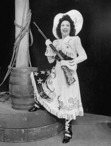 "Ethel Merman in the role that would give her the anthem with which she'd be identified, ""There's No Business Like Show Business."""