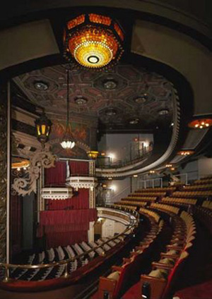 Belasco is said to watch plays and rehearsals from the balcony.